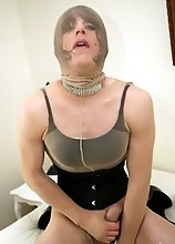 Slutty Zoe puts in nylon mask and suit and spreads asshole