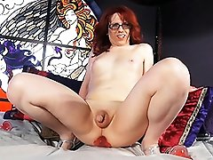 Naughty redhead Wendy fucks a toy