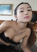 22 year old Thai shemale teases tourist on camera in her black dress