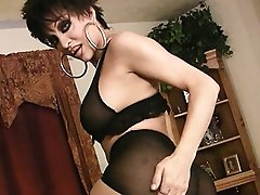 Naughty transsexual Kourtney pleasuring in sexy black stockings