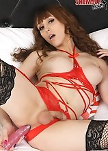 Beautiful Grooby girl Kylie Maria is horny and ready to get into bed in her sexy red lingerie! Watch as this stunning tgirl plays with her succulant b