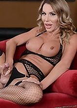 Marissa Minx in hot fishnet undies shows off her massive cock and plays with it