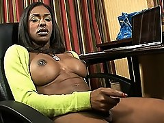 Seductive ebony transsexual Natalia Coxxx masturbating