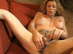 Horny transsexual MILF stroking off her hard cock