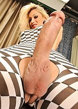 Barbarella, very elegant and nice blonde shemale with a long cock dominates Bagos